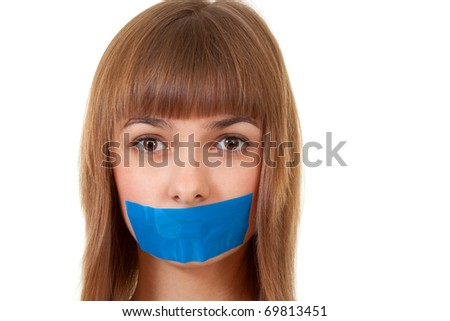 beautiful girl with her mouth sealed with blue tape - stock photo