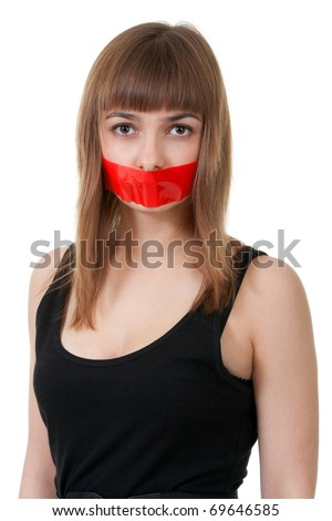 beautiful girl with her mouth sealed with red tape - stock photo