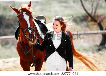 Beautiful girl with horse outdoors - stock photo