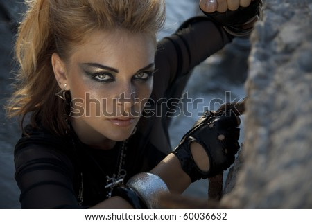 Beautiful girl with intensive makeup in a rock style