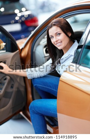Beautiful girl with keys in a car - stock photo