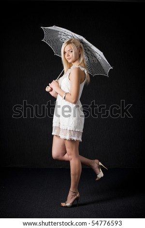 beautiful girl with knitted umbrella - stock photo