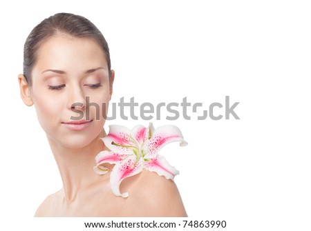 Beautiful girl with lily on a shoulder on a white background, closeup, textspace