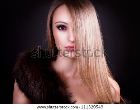 beautiful girl with long hair and fur - stock photo