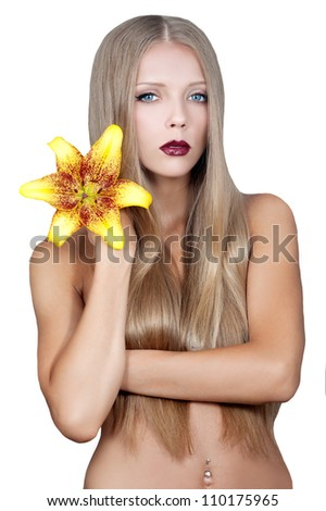 beautiful girl with long hair and the flower of the Lily in her hand - stock photo