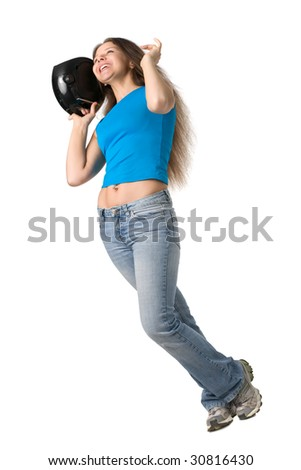 beautiful girl with long hair dances with music player in hand, isolated on white - stock photo