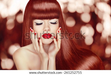 Beautiful girl with Long Hair. Fashion Woman Portrait. Makeup. Manicured nails. Healthy Glossy Red Hairstyle. - stock photo