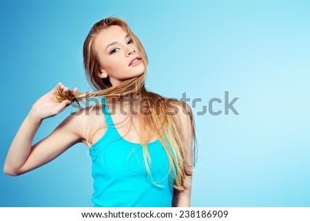 Beautiful girl with long hair. Hair care, healthy hair.  - stock photo