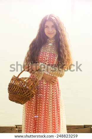 beautiful girl with long hair in a dress on the river. Retro style - stock photo