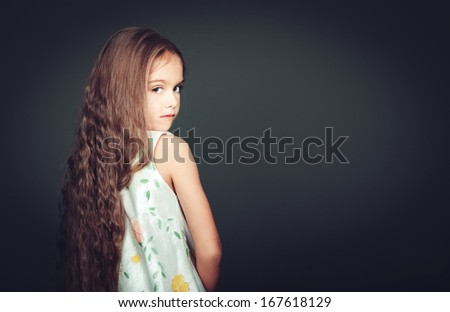 Beautiful girl with long hair in studio  - stock photo