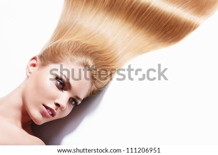 Beautiful girl with long hair isolated - stock photo