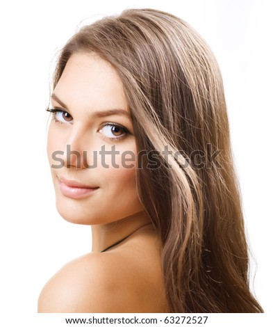 Beautiful Girl with long hair. Portrait over white.Perfect Skin - stock photo