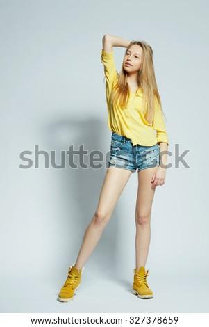 beautiful girl with long hair posing in studio - stock photo
