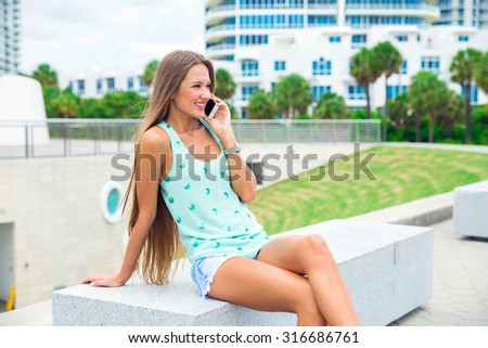 beautiful girl with long hair talking on the phone mobile - stock photo