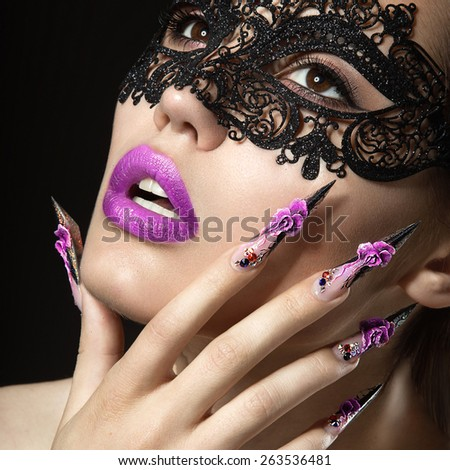 Beautiful girl with long nails and sensual lips. Portrait shot in the studio on a black background.Beauty face. - stock photo