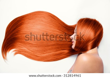 beautiful girl with long red hair