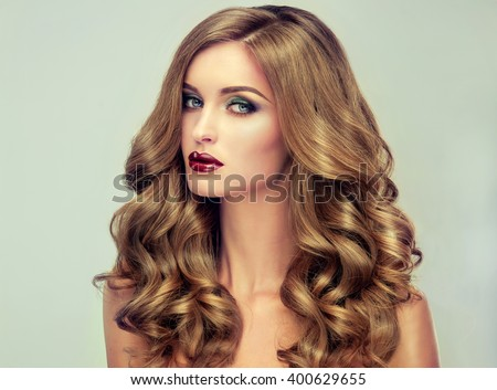 Beautiful girl long wavy hair fairhaired stock photo 400629709 beautiful girl with long wavy hair fair haired model with curly hairstyle and fashionable urmus Images