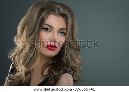Beautiful girl with long wavy hair Woman brunette with curly hairstyle - stock photo