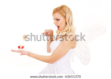Beautiful girl with magic wand and gift isolated on white background