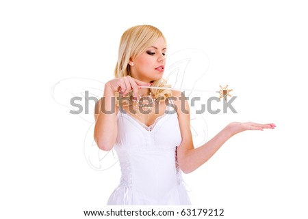 Beautiful girl with magic wand doing magic. Isolated on white background.