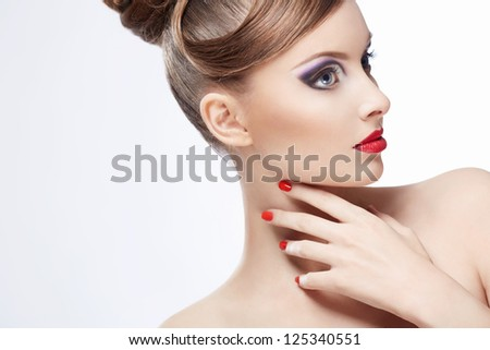 Beautiful girl with make-up indoors - stock photo