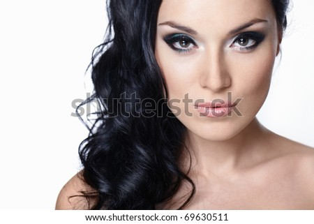 Beautiful girl with makeup and hair on white background - stock photo