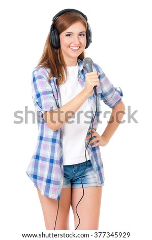 Beautiful girl with microphone and headphones, isolated on white background - stock photo