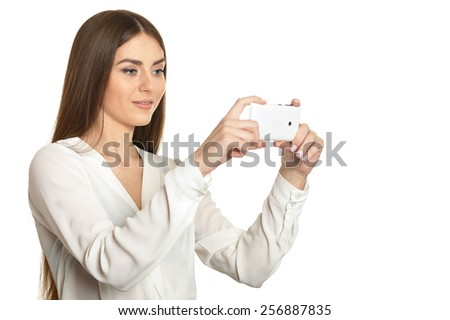 Beautiful girl with mobile phone on a white background - stock photo