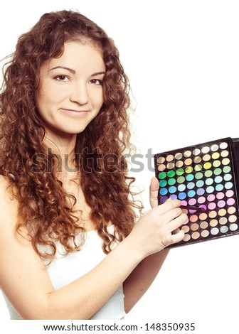 Beautiful girl  with multicolor eyeshadow palette on white background
