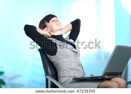Beautiful girl with notebook on chair - stock photo