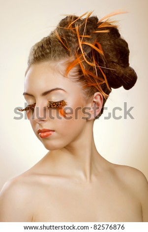 beautiful girl with orange feather lashes, dotted - stock photo