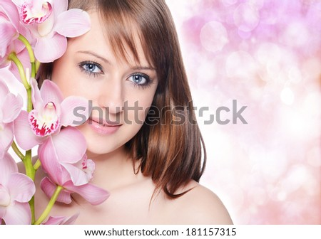 Beautiful Girl With Orchid Flowers - stock photo