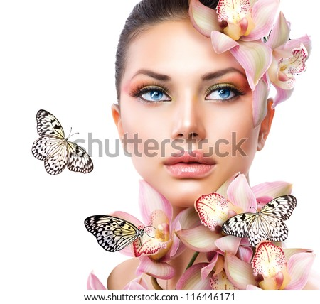 Beautiful Girl With Orchid Flowers and Butterfly. Beauty Face - stock photo
