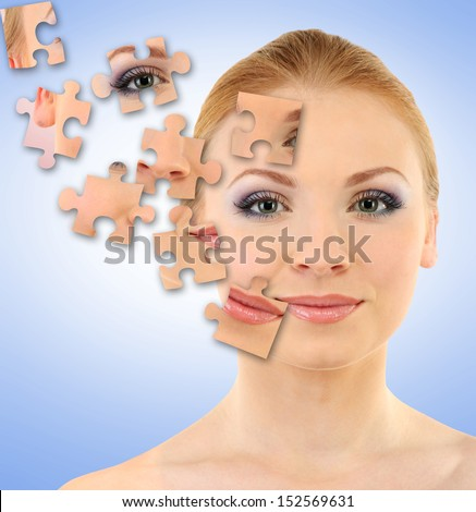 Beautiful girl with parts of skin on puzzles on blue background