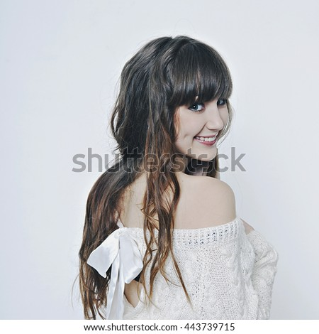 Beautiful girl with perfect hair. Beautiful girl in a white sweater - stock photo