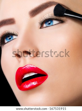 Beautiful girl with perfect make up on black background