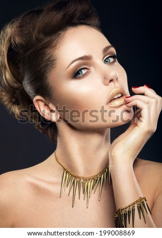 Beautiful girl with perfect skin and evening makeup. Portrait shot in the studio on a black background. - stock photo