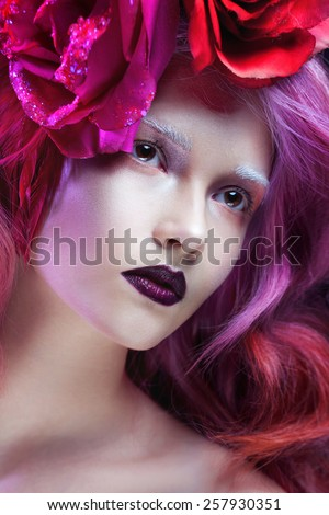 beautiful girl with pink hair, flowers in the hair - stock photo