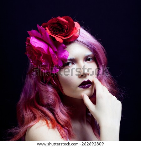beautiful girl with pink hair,  the hand of a face - stock photo