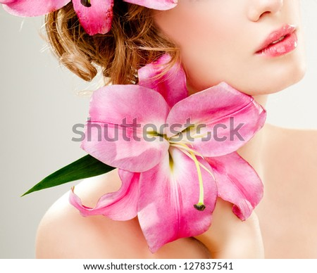 beautiful girl with pink lilies - stock photo