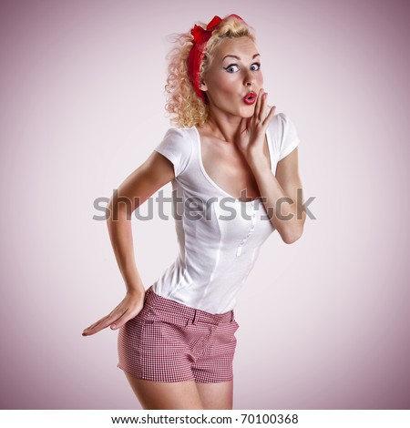 beautiful girl with pretty smile in pinup style on pink background - stock photo
