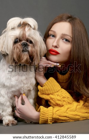 Beautiful girl with red lips and adorable Shih-tzu dog  - stock photo