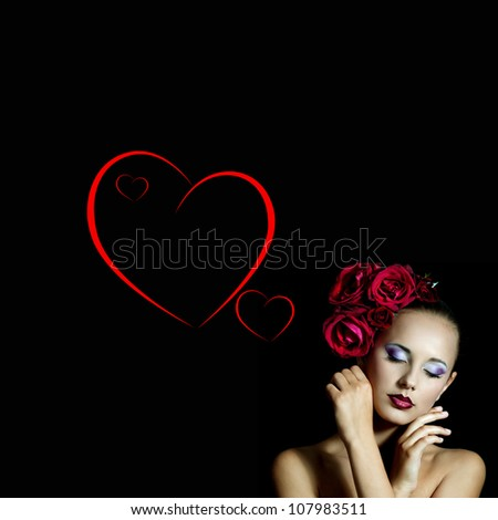 Beautiful girl with red roses in her hair.Valentine's day - stock photo