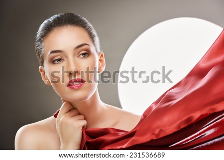 beautiful girl with red scarf - stock photo