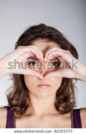Beautiful girl with romantic symbol