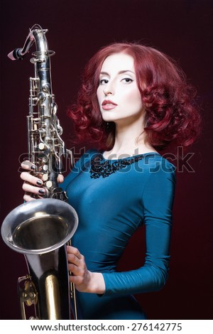 beautiful girl with saxophone.young sexy woman play sax.musical instrument.jazz - stock photo