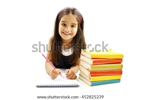 Beautiful girl with school books on the table. Isolated on white background