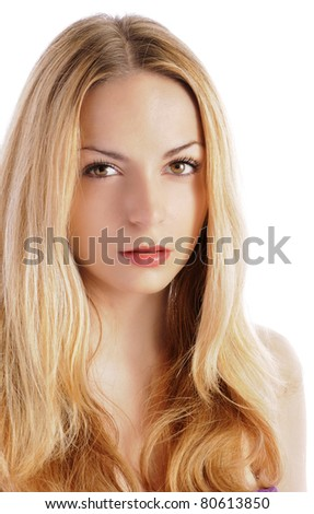 Beautiful girl with serious expression, isolated on white - stock photo