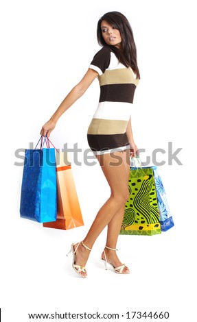Beautiful girl  with shopping bag,  isolated on white