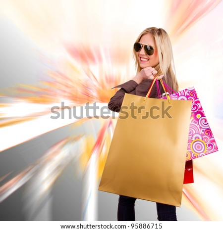 Beautiful girl with shopping bags - stock photo